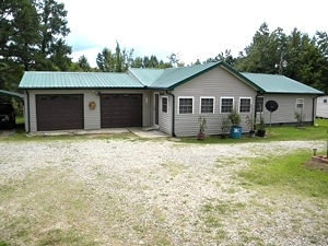 2609 Buck Creek Rd. | 3 bdrm, 2 bath home w/vinyl exterior and log interior, central heat and air, 2 car attached garage $105,000