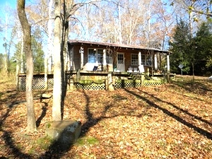 2127 River Rd., Wmsbg | Looking for a place to get away?  This property features a small cabin on the Cumberland River $39,900