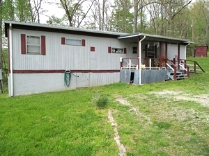308 Maple Creek Rd., Williamsburg | 12 X 60 (1973) mobile unit with a 12 X 18 bonus room added on. $24,000