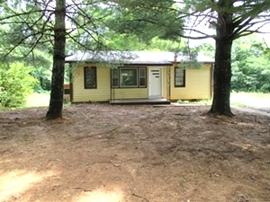1034 White Town Loop Rd., Williamsburg  |Five acres +- with a small house in need of some TLC.  $55,000