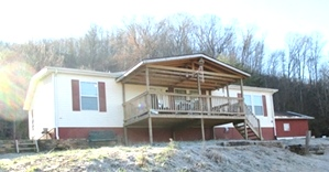 2.5 acres +/-, 3 bdrm., 2 baths dblwd.(30' X 54'), , FREE GAS, 24' X 30' two car detached garage.