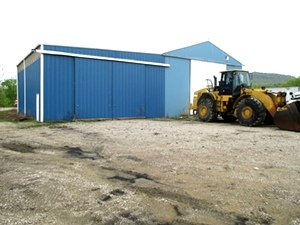 Commercial property: Equipment repair, storage and office space.