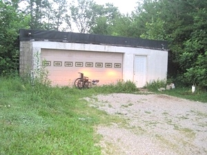 SOLD!  Finished basement and 2 + acres of land all at $14,000.