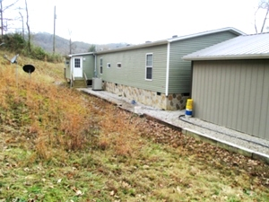 SOLD!  2694 Buck Creek Road | : 28'X60' KABCO doublewide located on 20 acres +/-. 4 bedrooms, 2 baths