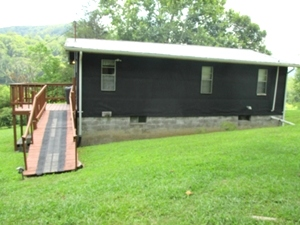 Sold! 860 Harps Ck. | 864 sf +/- home on 1.5 acres. Living rm., two bedrooms, eat-in-kitchen, one bath w/ laundry hook ups.