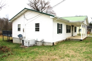 Reduced! 1665 Hwy 26, wmsbg | Good starter home or rental. Three bedroom frame home, vinyl siding, central heat and air,